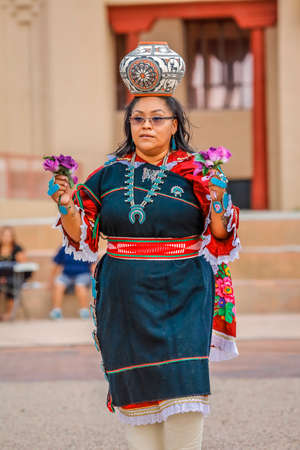 Zuni Indian, a Pueblo woman balances pot on her head in ceremony in Gallup, New Mexico, July 21, 2016 - Government Center Plaza Editorial