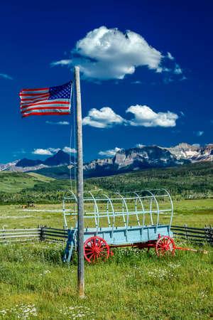 US Flag and covered wagon, Hastings Mesa, near Ridgway, Colorado.