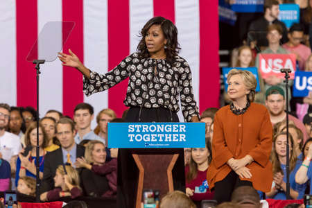 WINSTON-SALEM, NC - OCTOBER 27 , 2016: First Lady Michelle Obama introduces Democratic presidential candidate Hillary Clinton at a presidential campaign event. Éditoriale