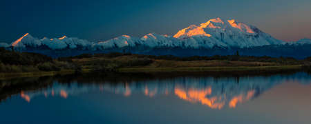 Mount Denali at Wonder Lake, previously known as Mount McKinley, the highest mountain peak in North America, at 20, 310 feet above sea level. Located in the Alaska Range, Denali National Park and Preserve, Alaska - shot at Sunrise.