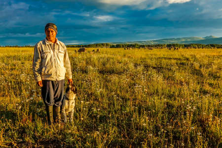 July 17, 2016 - Sheep herder with dog on Hastings Mesa near Ridgway, Colorado from truck