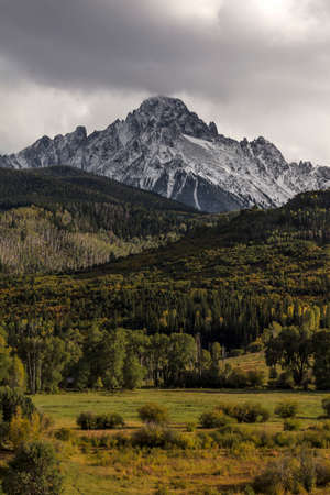 Early autumn color leads to Mount Sneffels and San Juan Mountains in Autumn, outside Ridgway, Colorado