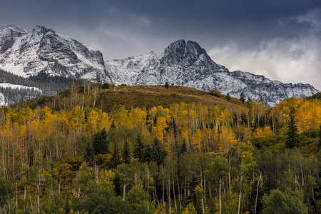 September 23, 2017 - Autumn color leads to Mount Sneffels and San Juan Mountains in Autumn, outside Ridgway, Colorado Stock Photo
