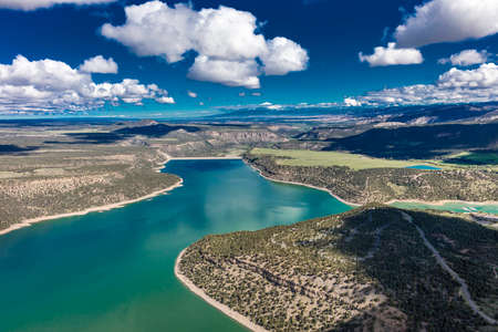 April 27, 2017 RIDGWAY COLORADO - Aerial of Ridgway State Park and Reservoir, Ridgway Colorado with white puffy clouds