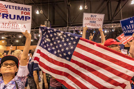AUGUST 22, 2017, PHOENIX, AZ   U.S. Crowds hold signs for President Donald J. Trump at the Phoenix Convention Center during a Trump rally Editorial