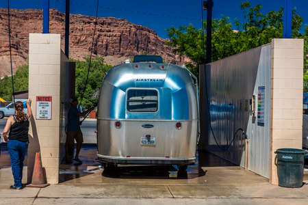 APRIL 27, 2017 - MOAB, UTAH - AIR STREAM TRAILER at car wash being cleaned