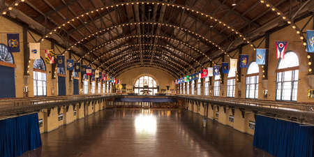 ANNAPOLIS, MARYLAND - APRIL 9, 2018 - Dahlgren Hall on the campus of the United States Naval Academy, Annapolis, Maryland shows fifty state flags