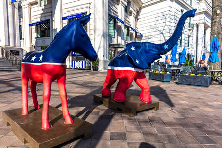 APRIL 11, 2018 - WASHINGTON DC - Democratic Mule and Republican Elephant statues symbolize American 2-part Political system in front of Willard Hotel Editorial