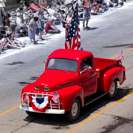 TELLURIDE, COLORADO, USA - July 4, 2018 - Annual  Independence Day Parade, Telluride, Colorado Colorado Avenue - features vintage Ford Red Pickup Truck