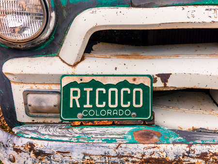 RICO COLORADO JULY 3, 2018, USA - Old Chevy Pickup truck with custom Colorado License plate saying RICOCO, Rico, Colorado Publikacyjne