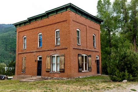 RICO COLORADO JULY 3, 2018, USA -Vintage red brick home Rico, Colorado