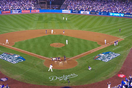 OCTOBER 26, 2018 - LOS ANGELES, CALIFORNIA, USA - DODGER STADIUM: Outfielder Cory Bellinger throws out Boston's Ian Kinsler as Austin Barnes tags him out - LA Dodgers defeat Boston Red Sox 3-2 in game 3 the longest game in World Series History - 18 inning