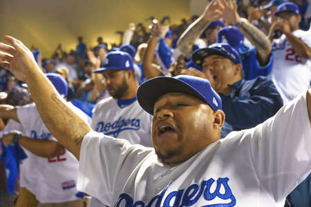OCTOBER 26, 2018 - LOS ANGELES, CALIFORNIA, USA - DODGER STADIUM: fans celebrate as LA Dodgers defeat Boston Red Sox 3-2 in game 3, the longest game in World Series History - 18 innings, 7 hours , 20 minutes.