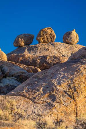 June 17, 2018 - TRONA, CALIFORNIA, USA - Three ball-like rocks, Pinnacles, Trona, California