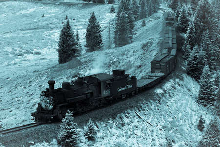 OCTOBER 9, 2018 - New Mexico, USA - Cumbres & Toltec Scenic Steam Train, from Chama, New Mexico to Antonito, Colorado over Cumbress Pass 10,015 Elevation - in Autumn and fresh snow - along Highway 17 Editorial