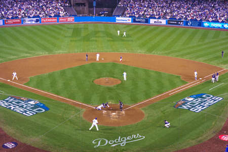OCTOBER 26, 2018 - LOS ANGELES, CALIFORNIA, USA - DODGER STADIUM: Outfielder Cory Bellinger throws out Bostons Ian Kinsler as Austin Barnes tags him out - LA Dodgers defeat Boston Red Sox 3-2 in game 3 the longest game in World Series History - 18 inning