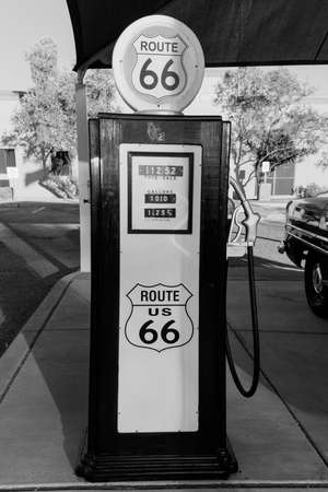 Kingman, Arizona, USA, July 2, 2018 - old Route 66, shows vintage Police Car and Gas Pump in black and white