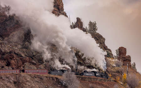 OCTOBER 9, 2018 - New Mexico, USA - Cumbres & Toltec Scenic Steam Train, from Chama, New Mexico to Antonito, Colorado over Cumbress Pass 10,015 Elevation - in Autumn and fresh snow - along Highway 17 Publikacyjne