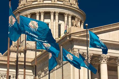 OCTOBER 11, 2018 Oklahma City USA -State Flag flies over Oklahoma State Capitol, Oklahoma City OK Publikacyjne