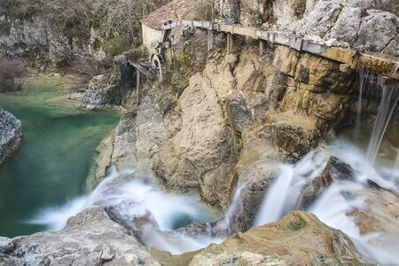 Small waterfalls on the mountain river