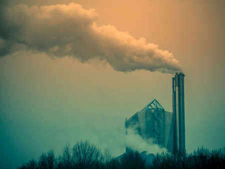 Chimneys of power plant producing huge amount of gas pollution