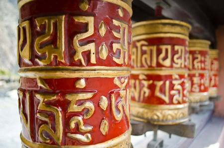 red prayer wheels in Nepal