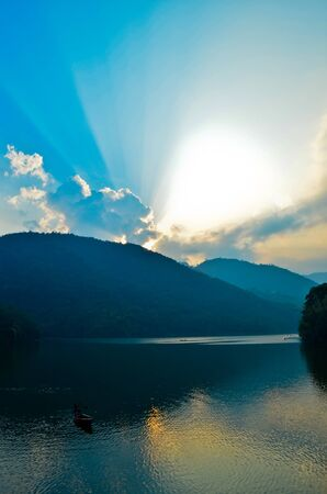 sunset at phewa lake in nepal photo