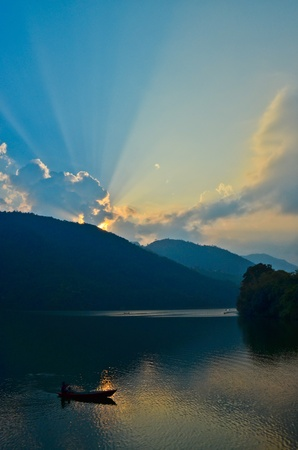 sunset at phewa lake in nepal