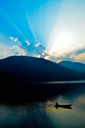 sunset at phewa lake in nepal Stock Photo - 11227850