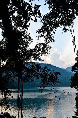 sunset at phewa lake in nepal Stock Photo - 11227935