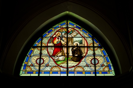 painting window in a church, thailand