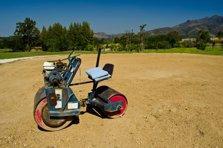vibrator: mini Steamroller parking on sand use in golf-course