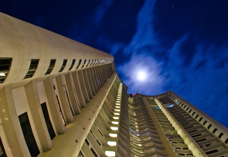 worms eye view of a condo in the middle of the night Stock Photo