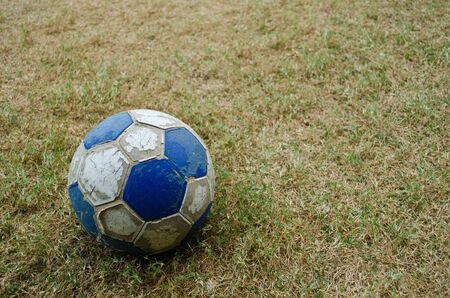 an old football on the ground photo