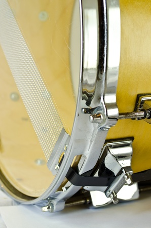 lugs of plywood snare drum isolatedon white background photo