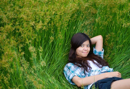 this girl is lying on the meadow enjoying her happy life photo