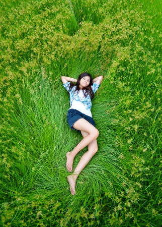 this girl is lying on the meadow and chilling out with her life