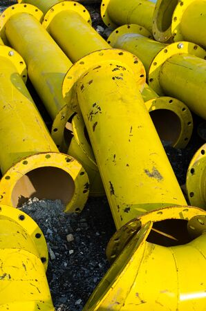 pile of old yellow steel pipe Stock Photo - 13408048