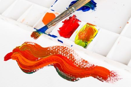 old paint brush and palette with warm tone colour Stock Photo