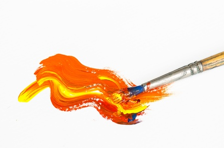 paint brush with orange painting on white background