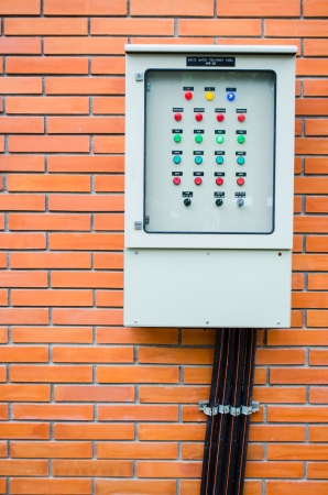 electric control box on brick wall photo