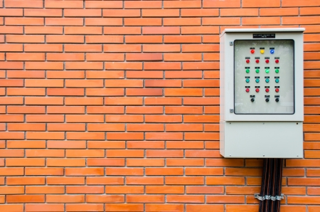 control box: electric control box on brick wall Stock Photo