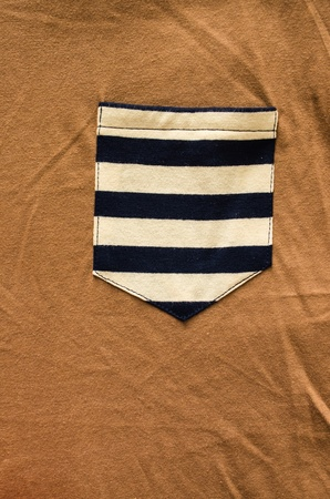 blue-white pattern pocket on brown shirt Stock Photo