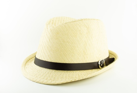 white weaving hat with brown belt on white background