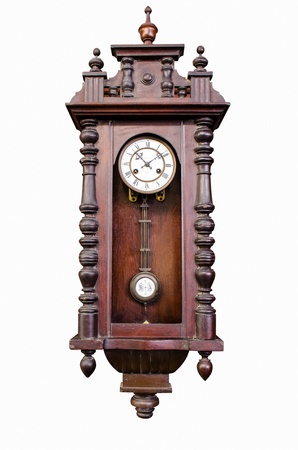 antique wooden pendulum clock isolated on white background photo
