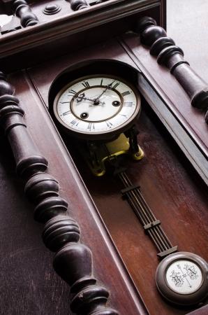 pendulum: closeup of antique beautiful wooden pendulum clock Stock Photo