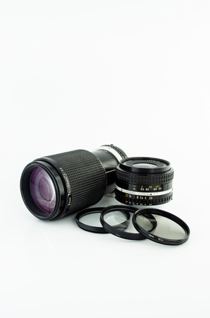 set of old camera lens and filter on white background