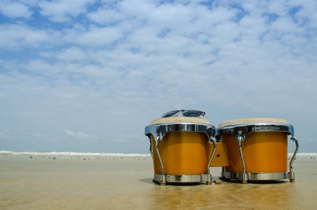 latin percussion called bongo on the beach Stock Photo