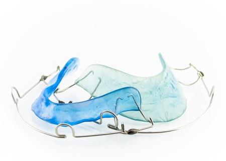 close up of blue dental braces isolated on white background