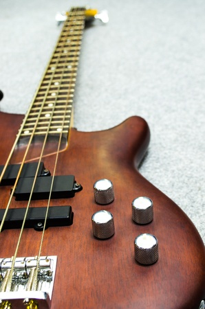 close up of a wooden bass with four volume controller photo